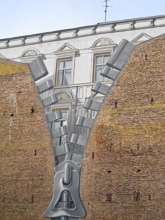 schildering van een rits sluiting op de muur