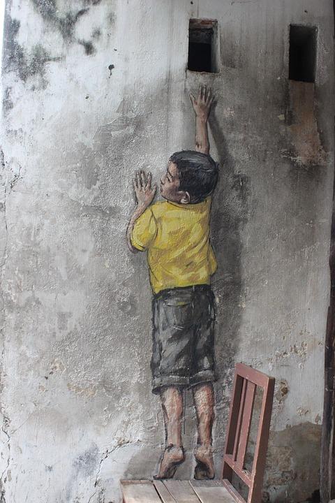 muurschildering van een jongen